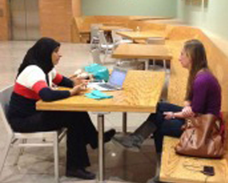 D-Lab Scale-Ups fellow Zubaida Bai (left) chats with conference attendee (right)