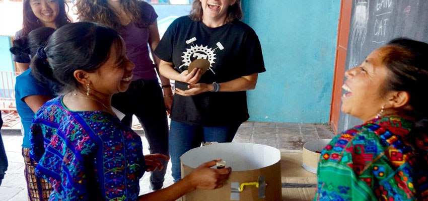 Community leaders Rosa and Maria try out cardboard prototype.