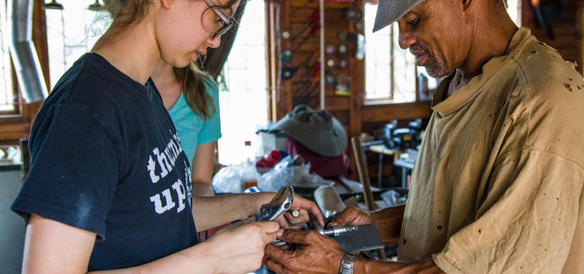 Caroline '20 working on assembling a drill chuck with Nico.