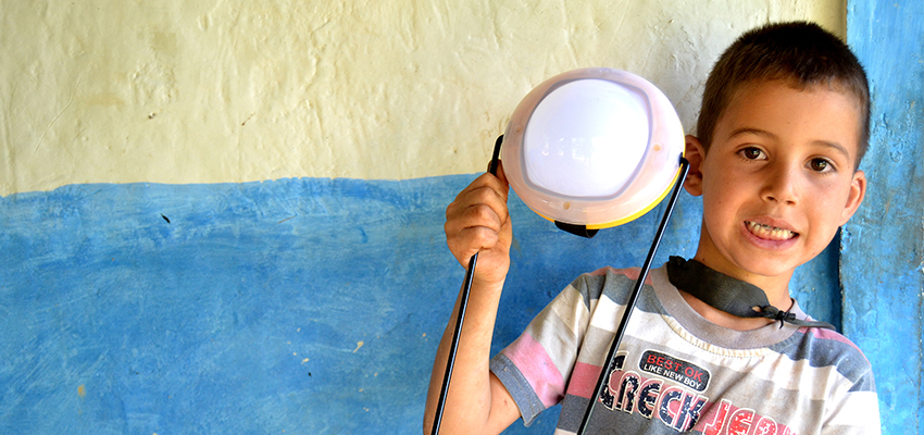 Boy with solar light, Morocco.